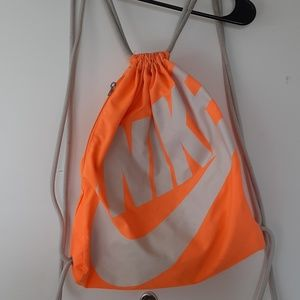 Neon orange Nike drawstring bag